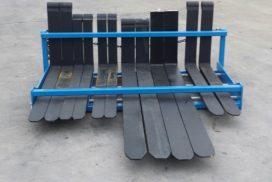 Front bar prevents forks falling sideways