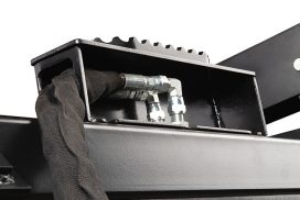 Steel covers and shields protect hydraulic lines